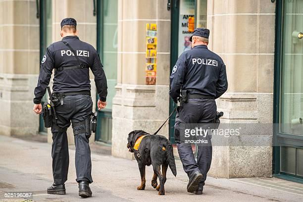 Policemen with dog on Zurich street, Switzerland