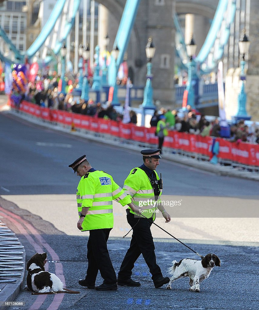 Policemen with their dogs search for explosives ahead of the Virgin London Marathon 2013 on April 21, 2013 in London, England.