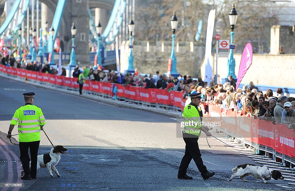 Policemen with their dogs search for explosives during the Virgin London Marathon 2013 on April 21, 2013 in London, England.