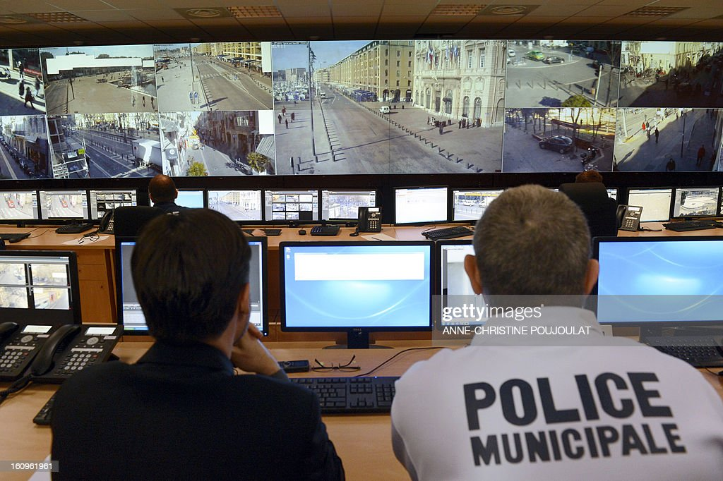 Policemen work at the real-time protection video operating room, where all Marseille's video-surveillance arrive, on February 8, 2013 in Marseille, southern France, during the inauguration of the Urban Supervision Centre (CSU).