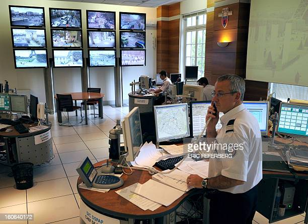 Policemen work in a video surveillance room at the police prefecture on October 5 2010 in Paris amid warnings by officials that France faces a...