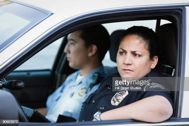 Policewoman and policeman in car