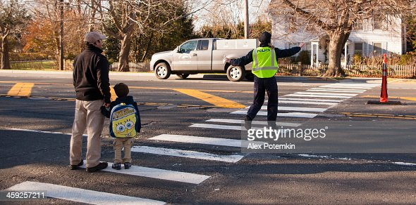 Policewoman assist to phaser and child crossing street