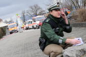 A policewoman is seen at the crime scene at the AlbertvilleSchool Centre on March 11 2009 in Winnenden near Stuttgart Germany According to media...