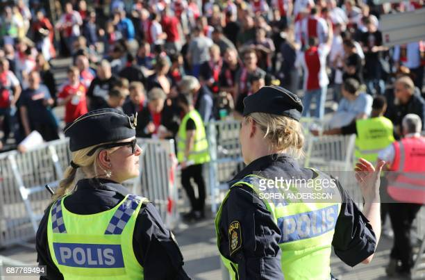 Policewomen stand guard prior to the UEFA Europa League final football match Ajax Amsterdam v Manchester United on May 24 2017 in Solna near...