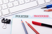 Policies and Procedures. Folder Register on a white Office Table