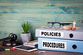 Policies and Procedures. Successful business, law and profit background