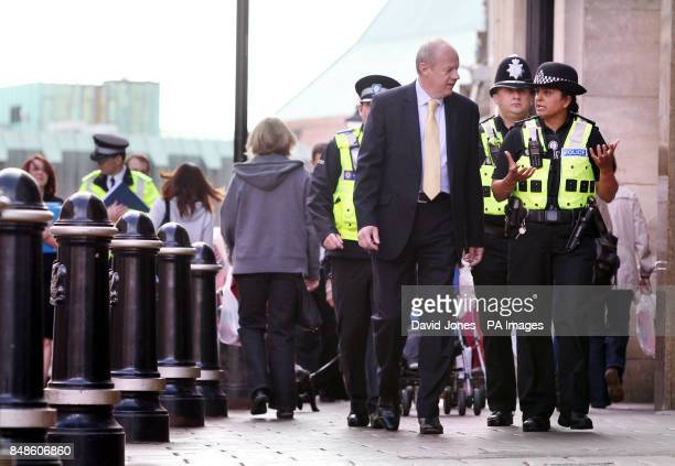 Policing Minister Damian Green MP talks to Sergeant Kelly Eaves as he meets Police officers in Coventry city centre today during his first walkabout...