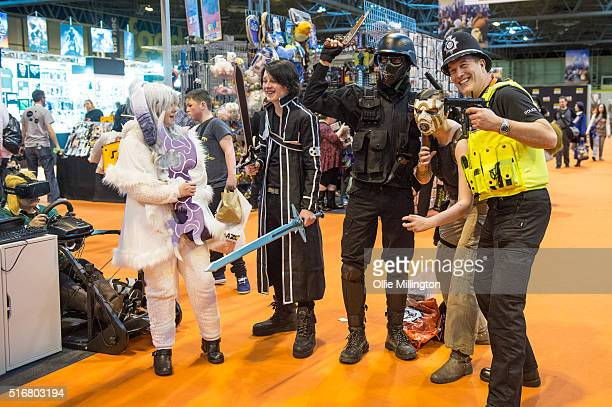 A policman poses with Cosplay enthusiasts attending as their favourite cult characters inlcluding a Umbrella Corp soldier from the Resident Evil...