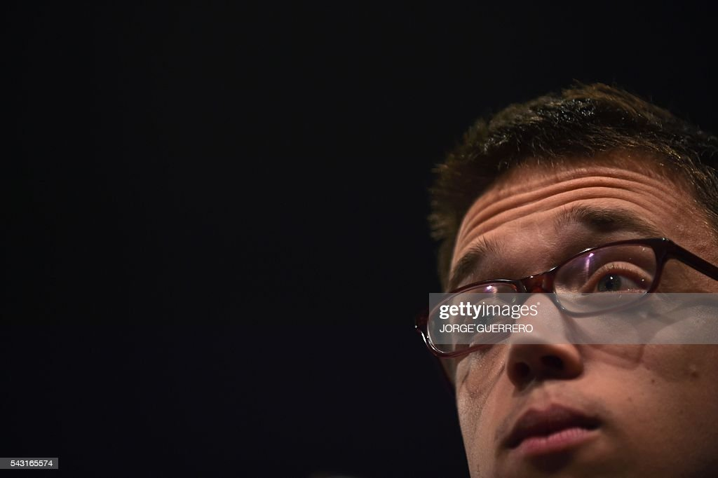 Policy secretary of left-wing party Podemos Inigo Errejon looks on during a press conference before the official results of Spain's general election in Madrid on June 26, 2016. Spain's second elections in six months was due to conclude on June 26 in much the same way as they did in December, with the incumbent conservatives winning tailed by the Socialist party, partial results showed. / AFP / JORGE