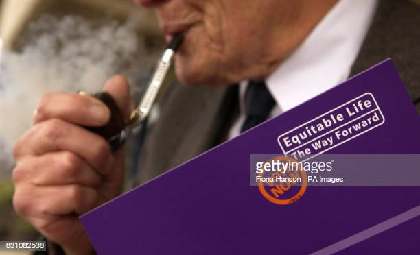 A policyholder waits to enter a meeting held by Equitable Life at Wembley Conference Centre London for policyholders to vote in person on compromise...