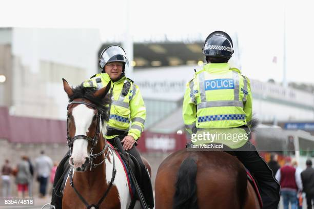 Poliice on horseback are seen outside the stadium prior to the Premier League match between Burnley and West Bromwich Albion at Turf Moor on August...