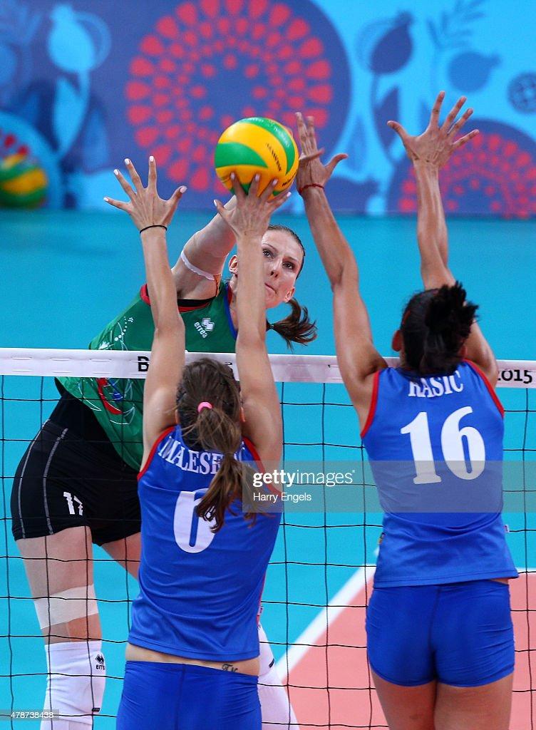 Polina Rahoimova of Azerbaijan (5) smashes the ball past Tijana Malesevic (6) and Milena Rasic (16) of Serbia during the Women's Volleyball bronze medal match between Azerbaijan and Serbia on day fifteen of the Baku 2015 European Games at the Crystal Hallon June 27, 2015 in Baku, Azerbaijan.