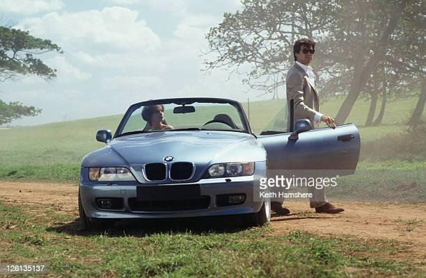 Polish actress Izabella Scorupco films a scene in Puerto Rico with Irish actor Pierce Brosnan and a BMW Z3 for the James Bond film 'GoldenEye' 1995