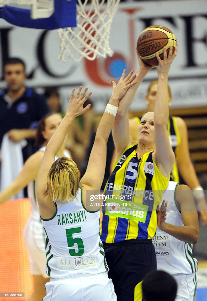 Polish Agnieszka Bibrzycka (R) of the Turkish Fenerbahce Istanbul scores a basket against Hungarian Krisztina Raksanyi (L) of Hungarian Hat-Agro UNI Gyor in Gyor on February 22, 2013 during their Euro League match.