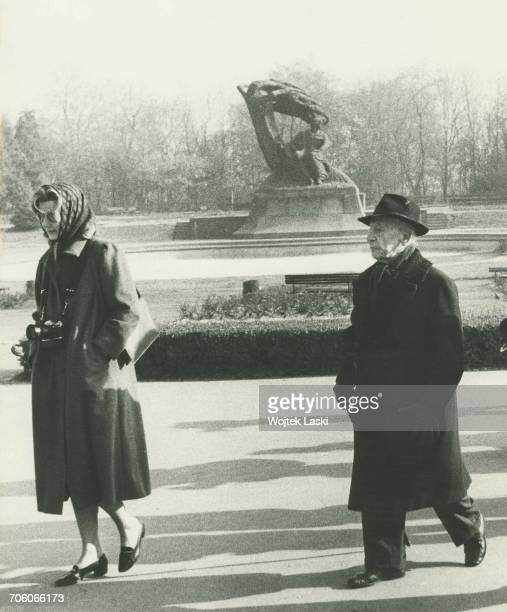 Polish American classical pianist Artur Rubinstein and his friend Annabelle Whitestone in front of the monument to Frederic Chopin in Lazienki Park...