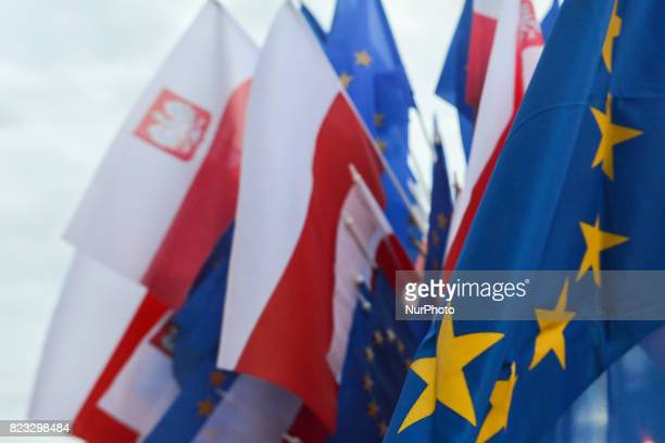 Polish and EU flags for sale near Krakow's District Court ahead of an antigovernment candlelit vigil on Wednesday evening where hundreds gathered for...
