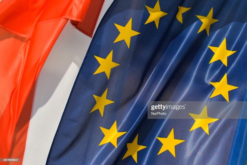 Polish and EU flags seen in Krakow's City Center. On Wednesday, August 22, 2017, in Krakow, Poland.