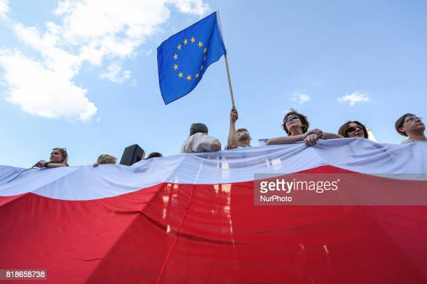 Polish and European Union flags during another day of protests against government plans for sweeping changes to Polands judicial system Krakow Poland...