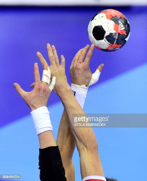 Polish and Norwagian players fight for the ball during the Men's 2016 EHF European Handball Championships match Poland vs Norway in Tauron Arena of...