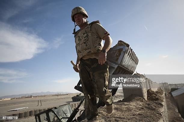 Polish Army soldier helps fill a Hesco barrier wall at an afghan observation post manned by units of the Afghan National Police ANP in Qarabagh...
