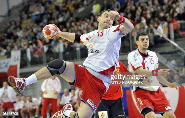 Polish Bartosz Jurecki scores a goal against Spain in the Olympic Hall of Innsbruck on January 24 2010 during the Euro 2010 Handball Main Round...
