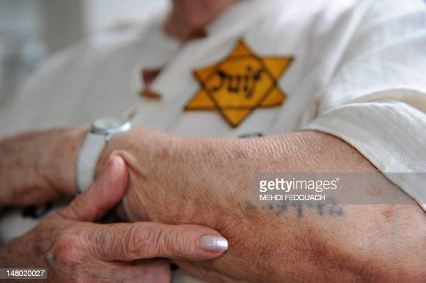 Polish born Sarah Montard one of the survivors of infamous Vel D'Hiv roundup shows her Birkenau prisoner identification tattoo as she wears the...