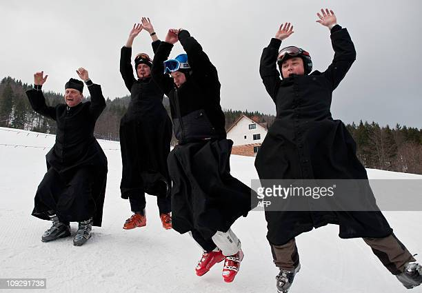 Polish Catholic priests warm up on February 12 2011 ahead of the 14th Alpine Ski Championships for clergymen in Wisla southern Poland AFP PHOTO /...