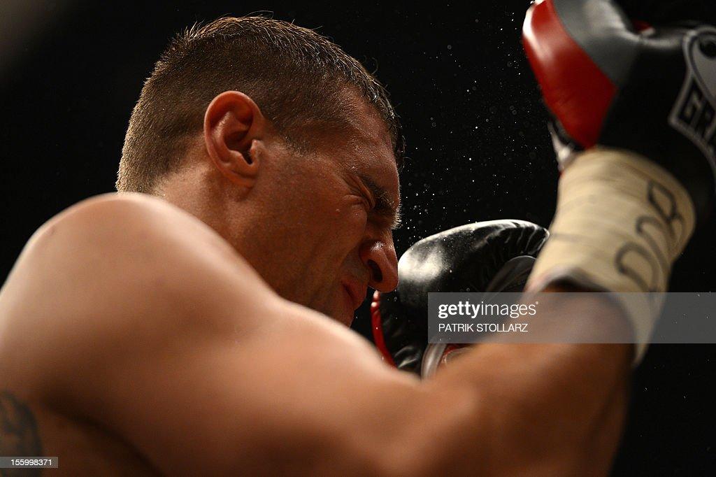 Polish challenger Mariusz Wach reacts during his fight against Ukrainian heavyweight boxing world champion Wladimir Klitschko in the IBF IBO WBO and...