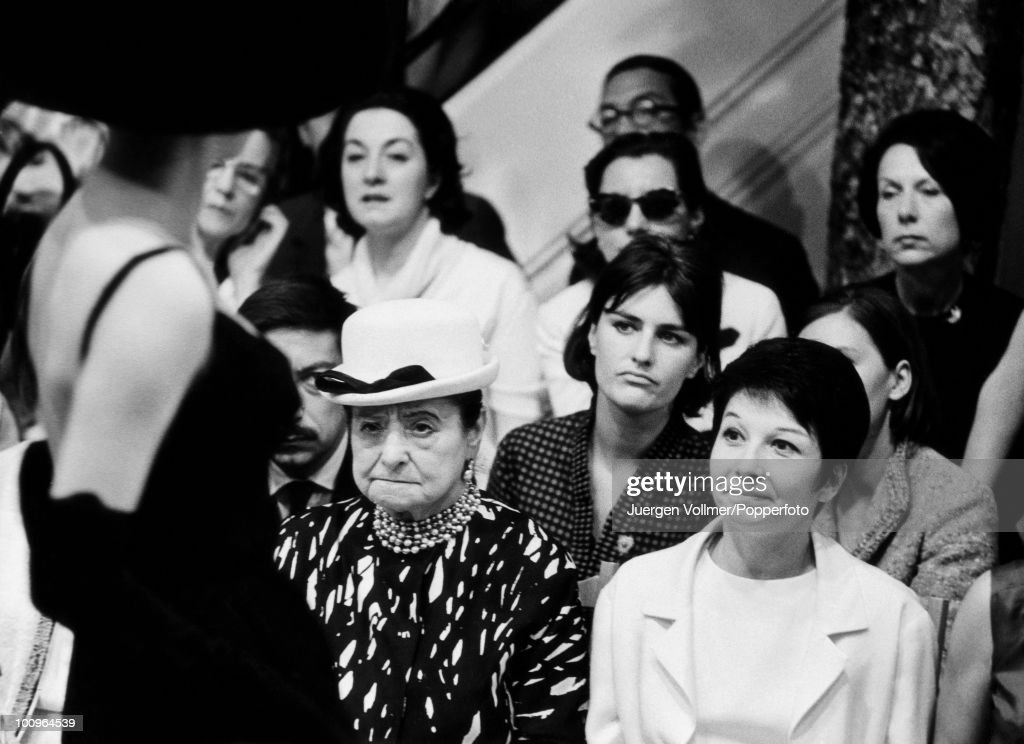 Polish cosmetics tycoon Helena Rubinstein (1870 - 1965) with dancer Zizi Jeanmaire at a fashion show in Paris, 1963.