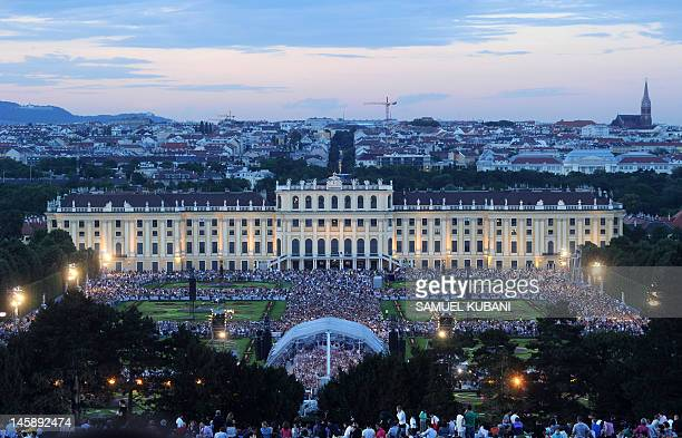 A Polish couple celebrate their wedding during an open air 'Summer Night' Vienna Philharmonic Orchestra concert backdropped by Schoenbrunn Palace in...