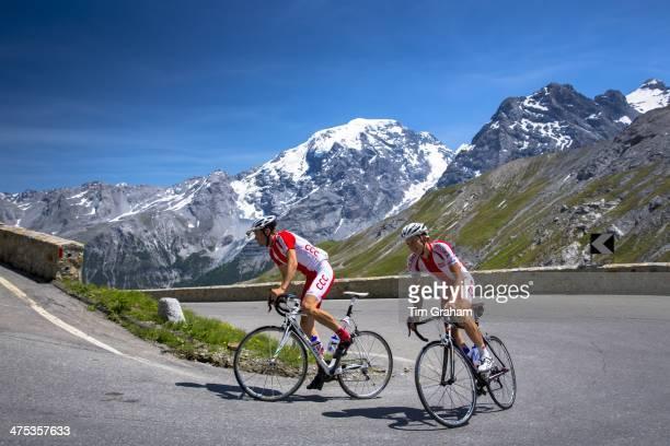 Polish cyclists ride roadbikes uphill on The Stelvio Pass Passo dello Stelvio Stilfser Joch in the Alps Italy