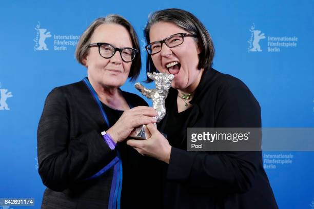 Polish director Agnieszka Holland and her daughter and codirector Kasia Adamik pose with their Silver Bear Alfred Bauer Prize backstage after the...