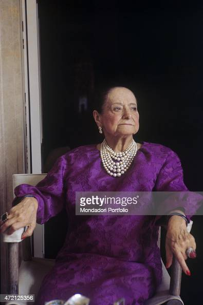'Polish entrepreneur Helena Rubinstein born Chaja Rubinstein poses in her villa wearing a lilac dress and pearls necklace New York April 1964 '