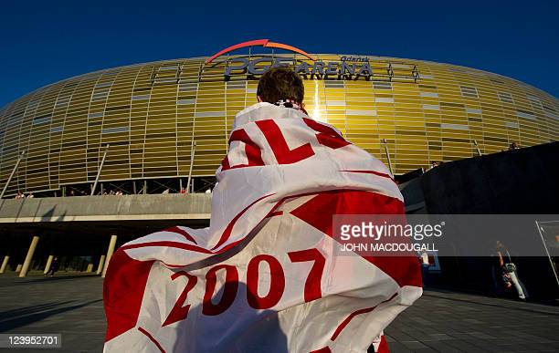 A Polish fan arrives in front of the stadium prior to the International friendly football match Poland vs Germany in the northern Polish city of...