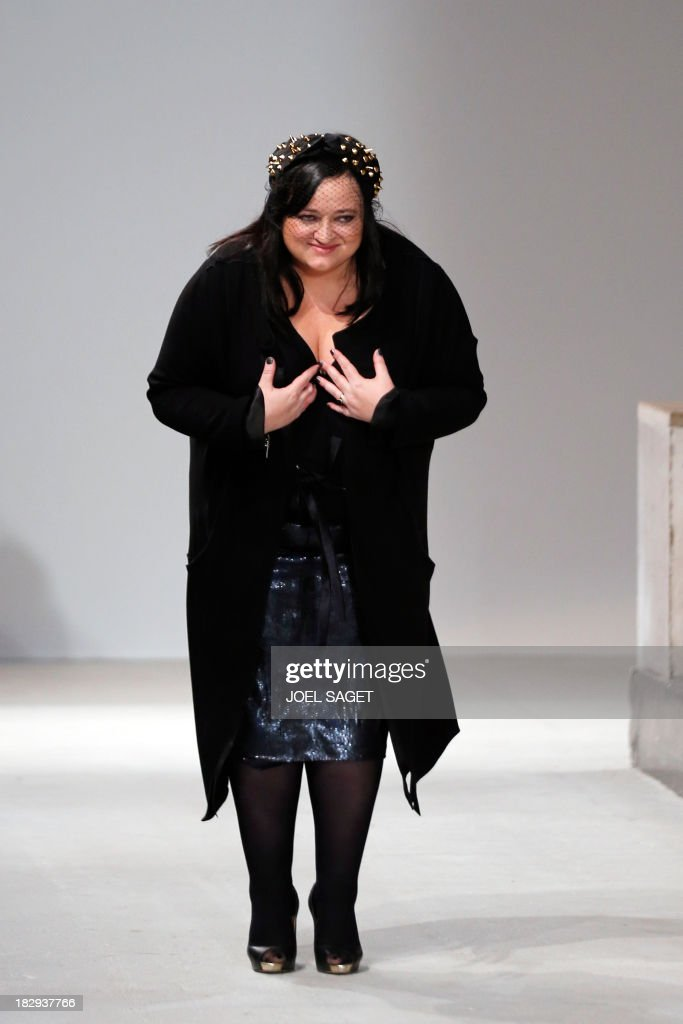 Polish fashion designer Gosia Baczynska acknowleges the public at the end of her 2014 Spring/Summer ready-to-wear collection fashion show, on October 2, 2013 in Paris.