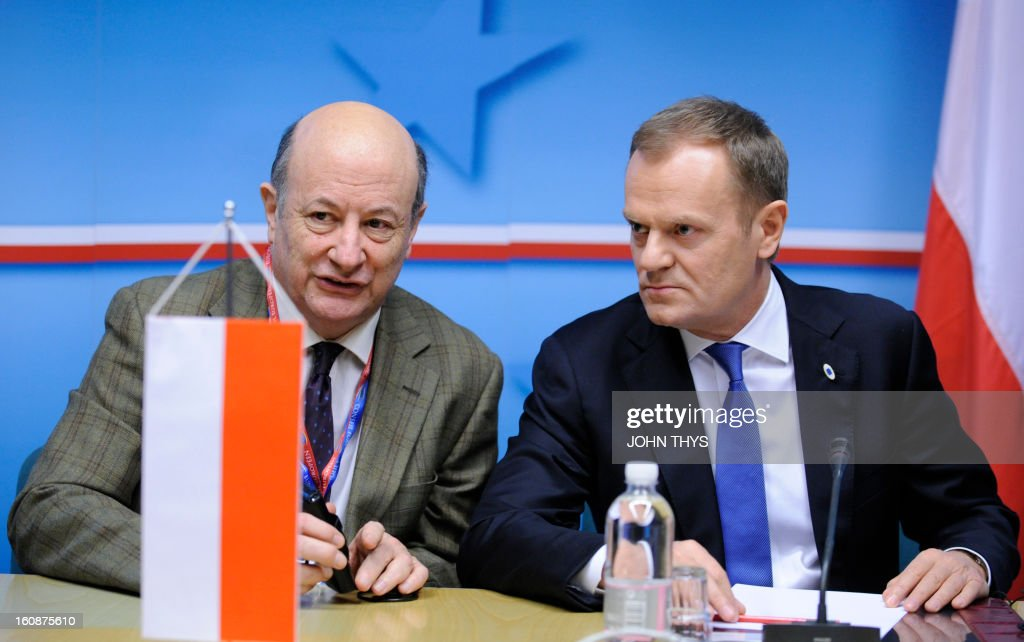Polish Finance Minister Jacek Vincent Rostowski (L) and Polish Prime Minister Donald Tusk chat during the 'friends of cohesion policy' group meeting at the European Parliament on February 7, 2013 in Brussels, on the first day of a two-day European Union leaders summit. European Union leaders head into a fresh clash over the EU's budget with the only certainty being that proposals for several years will be cut back.