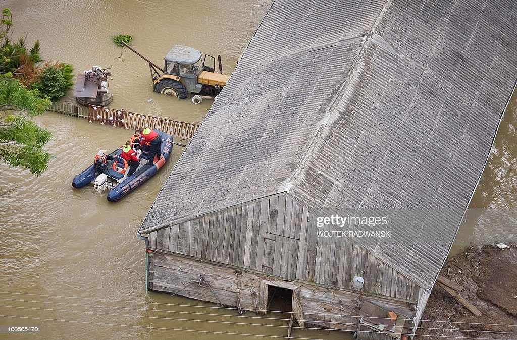 Polish firemen deliver food to residents in a flooded area in the village of Swiniary village central Poland at Wisla river on May 25, 2010.