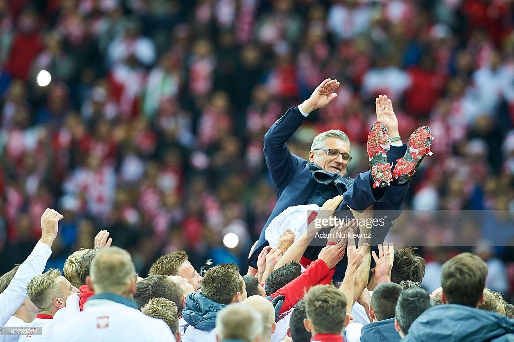 Polish football players toss their coach Adam Nawalka of Poland and celebrate after the UEFA EURO 2016 qualifying match between Poland and Republic of Ireland at National Stadium on October 11, 2015 in Warsaw, Poland.