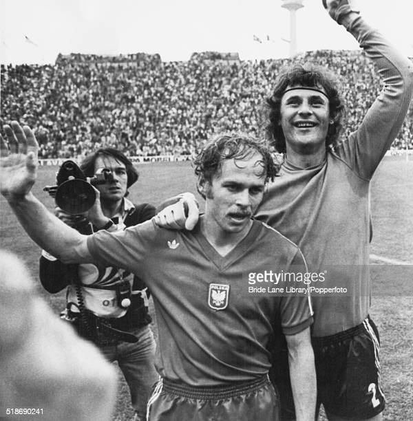 Polish footballers Grzegorz Lato and goalkeeper Jan Tomaszewski celebrate their 10 victory over Brazil in the World Cup Match for third place at the...