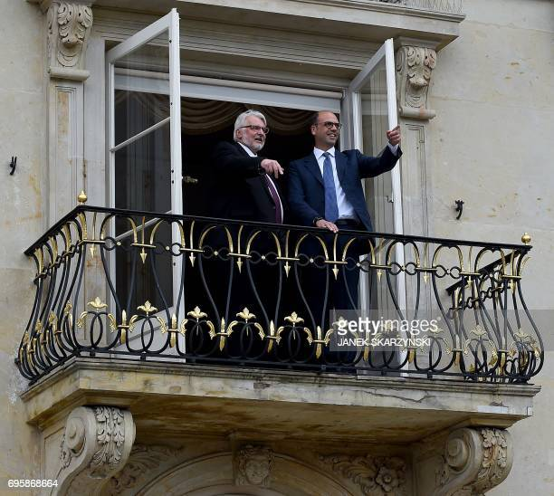 Polish Foreign Minister Witold Waszczykowski and his Italian couterpart Angelino Alfano stand on a balcony as they meet at the Palace on the Isle in...