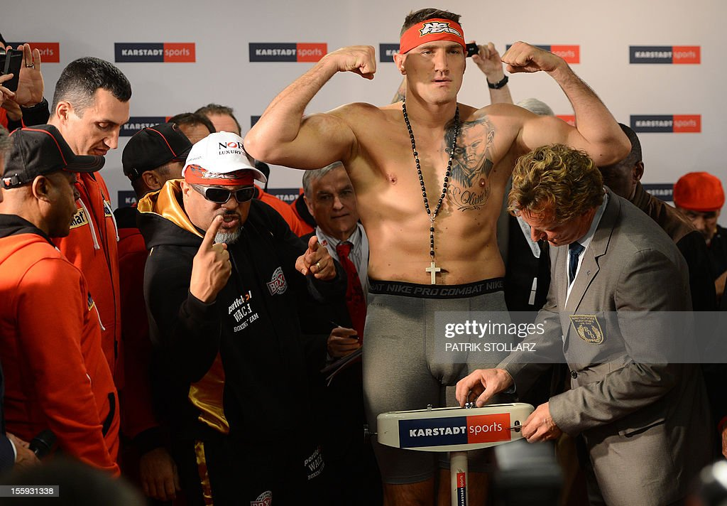 Polish heavyweight challenger Mariusz Wach poses during the official weighin on the eve of his IBF IBO WBO and WBA title fight against Ukraine boxing...
