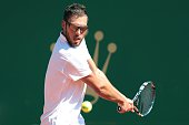Polish Jerzy Janowicz hits a return to Italian Fabio Fognini during the MonteCarlo ATP Masters Series Tournament tennis match on April 13 2015 in...
