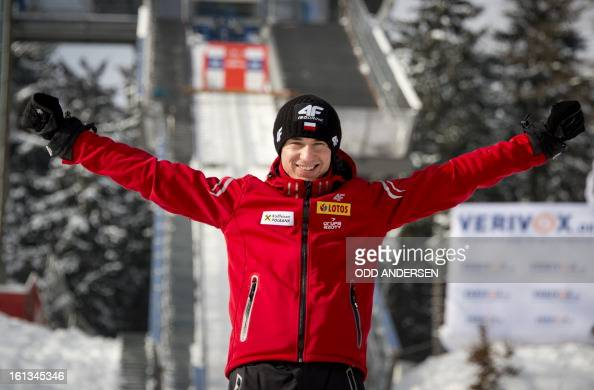 Polish jumper Kamil Stoch pose on the jump as wind delayed the start of the FIS Ski Jumping World Cup individual large hill competition on the...