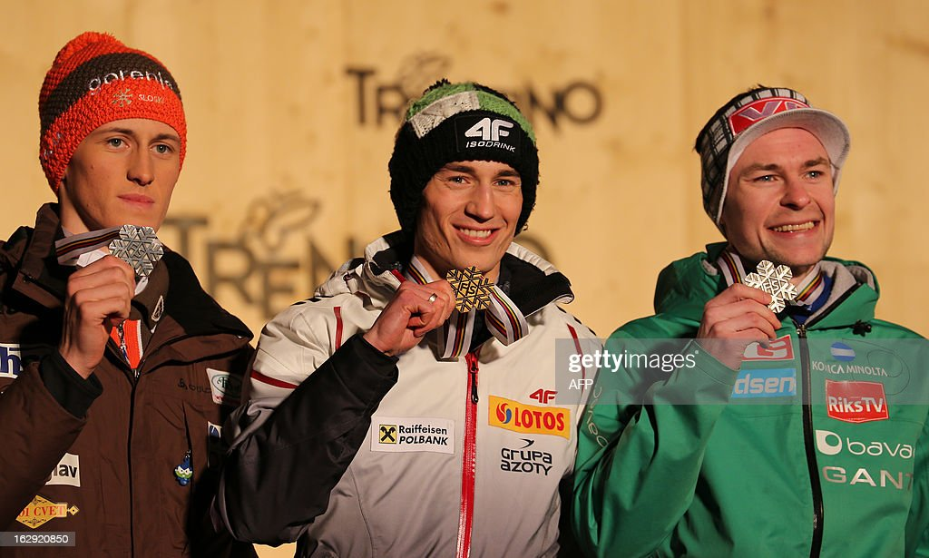 Polish Kamil Stoch (C) poses with his gold medal close to silver medalist Norway's Anders Jacobsen (R) and Slovenia's Peter Prevc bronze medalist on the podium of the medals' ceremony of the Men's Nordic Combined LH event of the FIS Nordic World Ski Championships in Cavalese, on March 1, 2013.