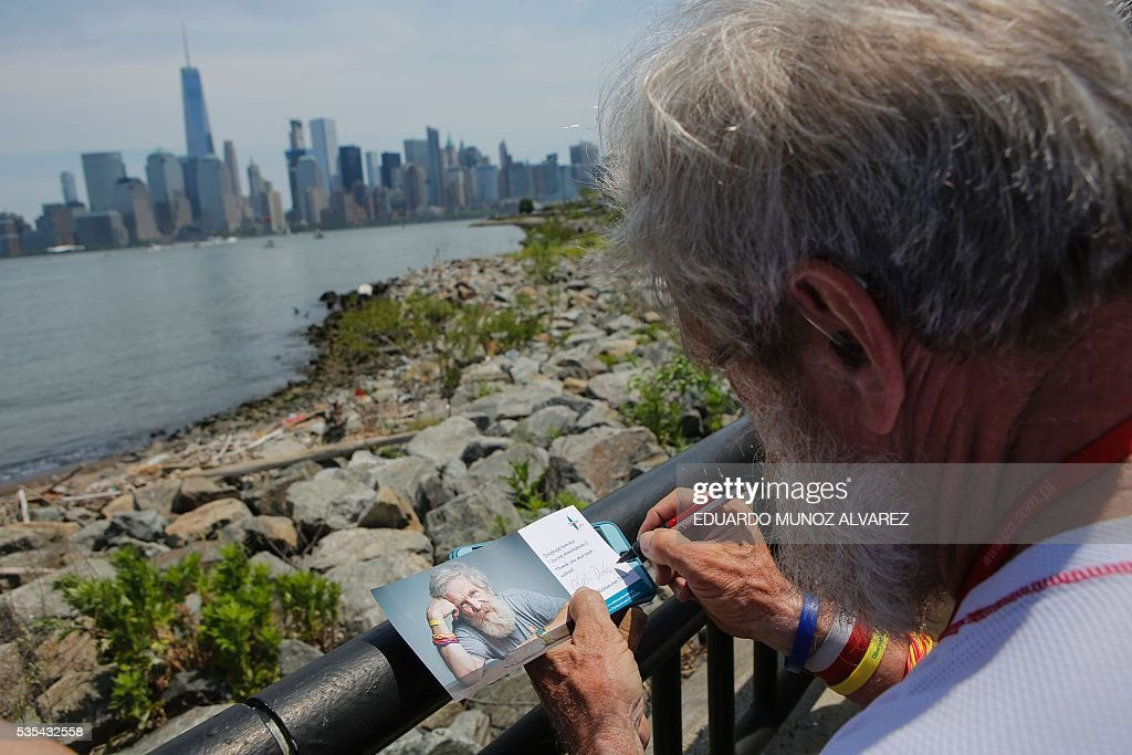 Polish kayaker Aleksander Doba signs flyers before the beginning of his transatlantic kayak adventure from New York to Lisbon on May 29, 2016 in New York. Doba says this will be his toughest challenge yet, but that he feels like a young man and 'will not pretend to be old.' / AFP / EDUARDO