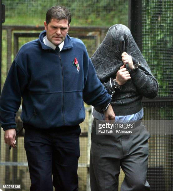 Polish man Henryk Gorski accused of murdering vulnerable Shirley Finlay is led away from Larne Magistrates court PRESS ASSOCAITION photo
