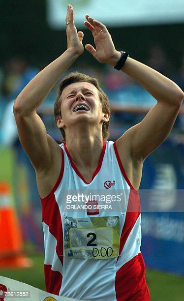 Polish Marta Dziadura jubilates as she crosses the tape of the 3000 meters female race to win with 5326 points the 2006 Modern Pentathlon World...