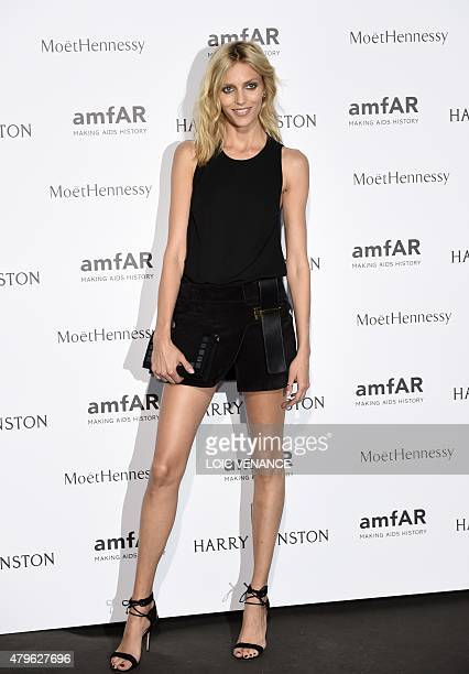Polish model Anja Rubik poses as she arrives for the amfAR dinner on the sidelines of the Paris fashion week in Paris on July 5 2015 AFP PHOTO / LOIC...