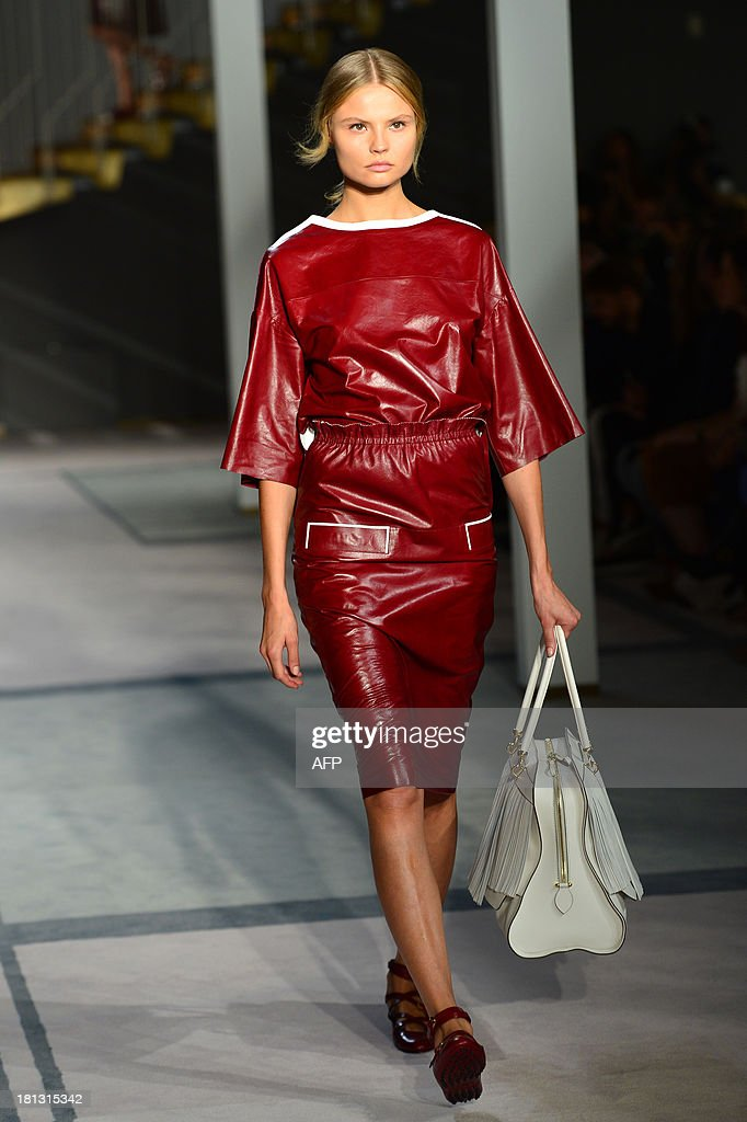 Polish model Magdalena Frackowiak presents a creation for fashion house Tod's as part of the spring/summer 2014 ready-to-wear collections during the fashion week in Milan on September 20, 2013.